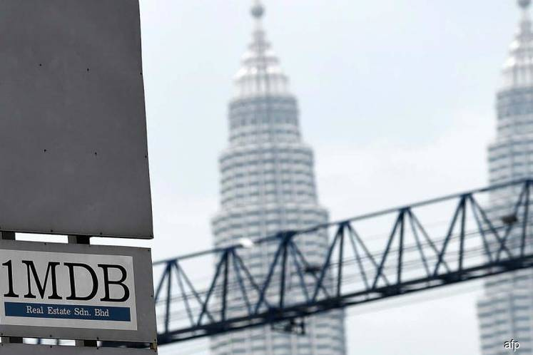 Malaysia CDS, 1MDB suggest credit downgrade can't be avoided