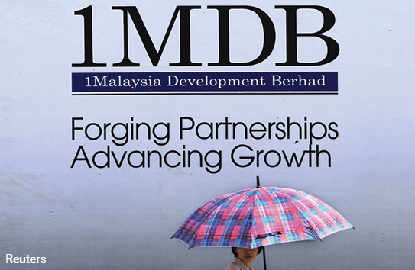 1MDB hits out at Dr M over 'stolen' money claim