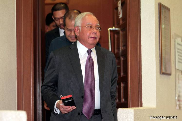 Najib's SRC trial postponed as defence co-counsels unwell, absent