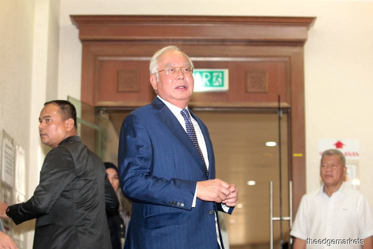 SRC trial adjourned until Monday due to Najib's eye infection