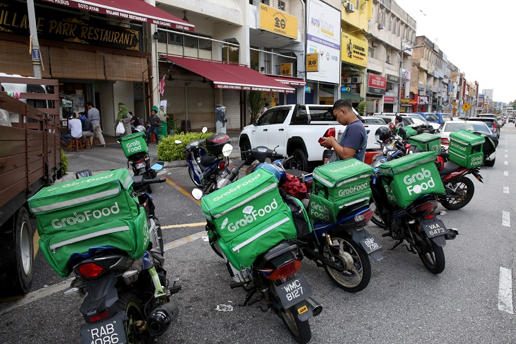 MoH mulls conducting Covid-19 screenings on food delivery riders