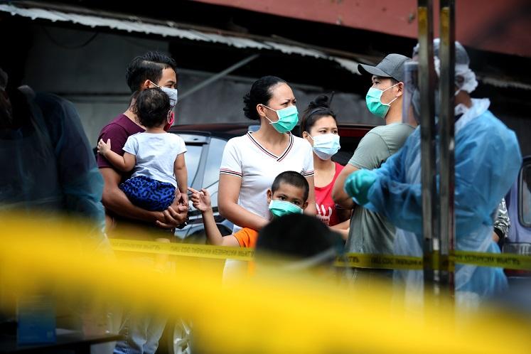 Under tight security, PKNS Kampung Baru folk undergo active screening for Covid-19