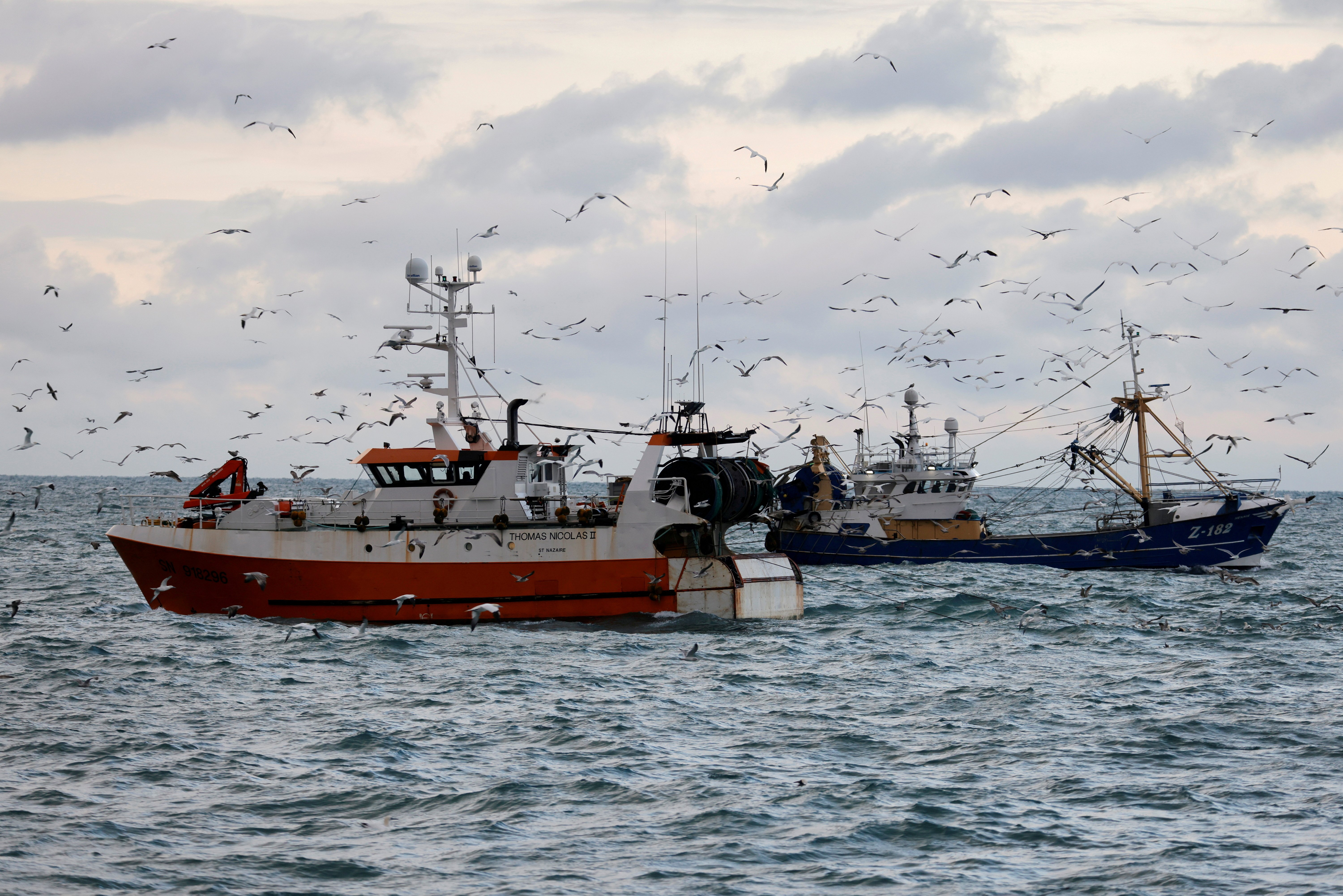 """The French trawler """"Thomas Nicolas II"""" sails past a Dutch trawler in the North Sea, off the coast of northern France, December 7, 2020. Picture taken with a drone December 7, 2020. (Reuters filepix)"""