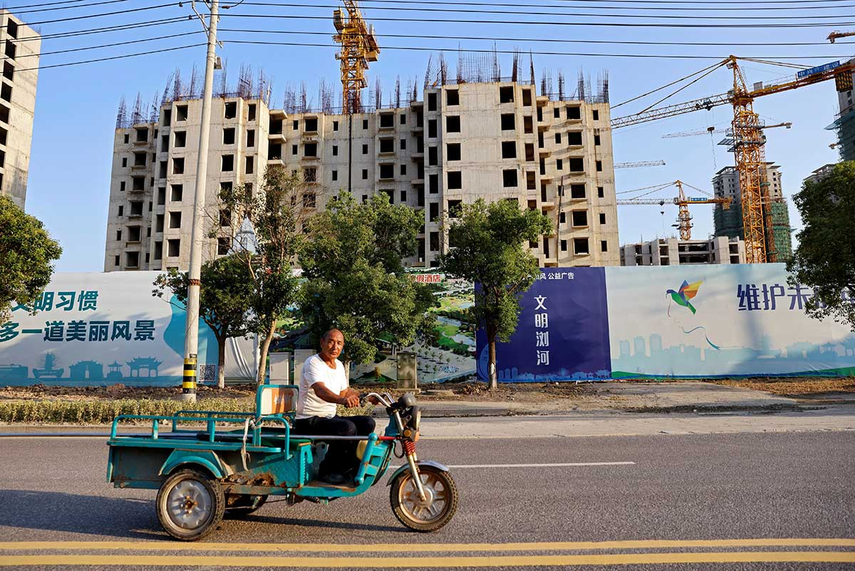 A man rides a vehicle past the construction site of Evergrande Cultural Tourism City, a project developed by China Evergrande Group, in Suzhou's Taicang, Jiangsu province, China on Sept 23. (Pix by Reuters)