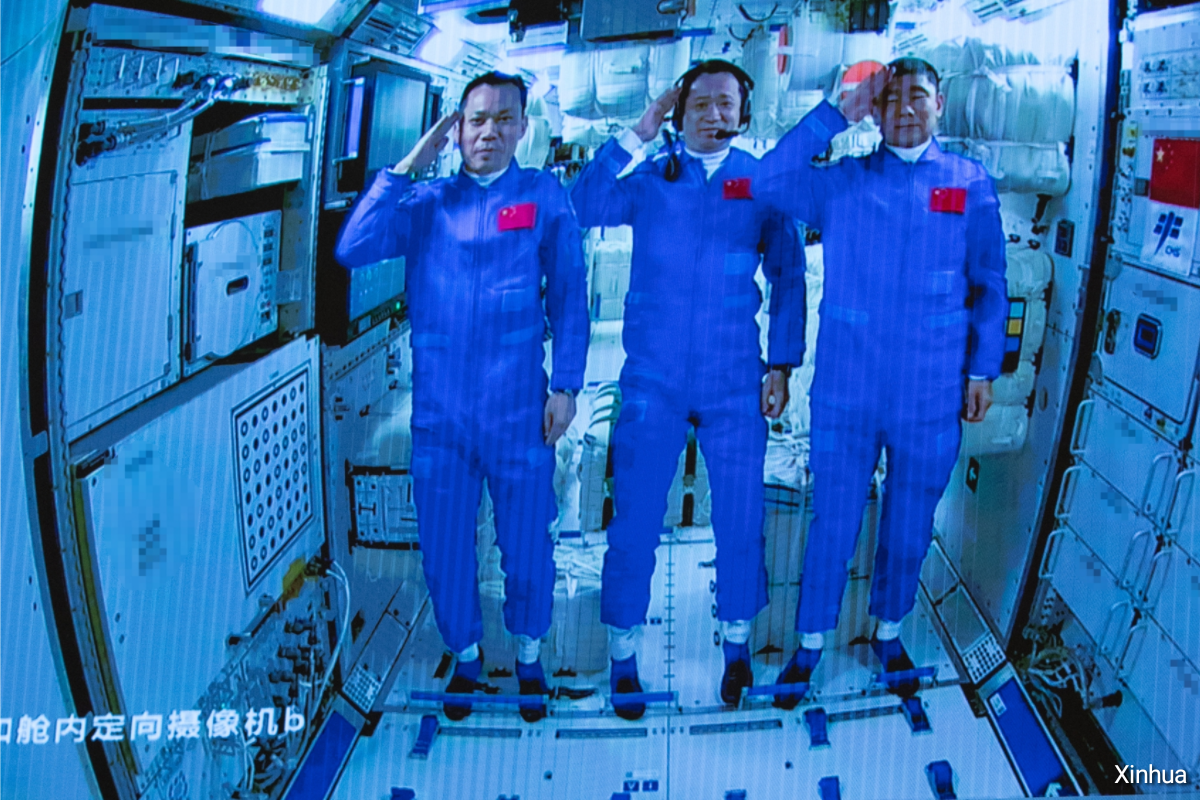 Three Shenzhou-12 astronauts, Tang Hongbo, Nie Haisheng and Liu Boming (from left) salute after entering the Tianhe core module on Thursday. Photo: Xinhua