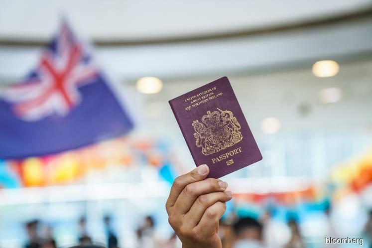 UK to give Hong Kong nationals way out after China crackdown