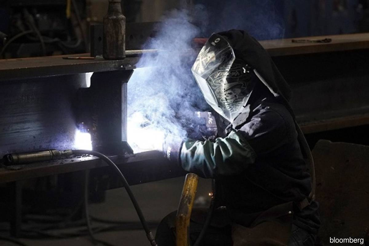 US factory output rises in March, shaking off winter weakness