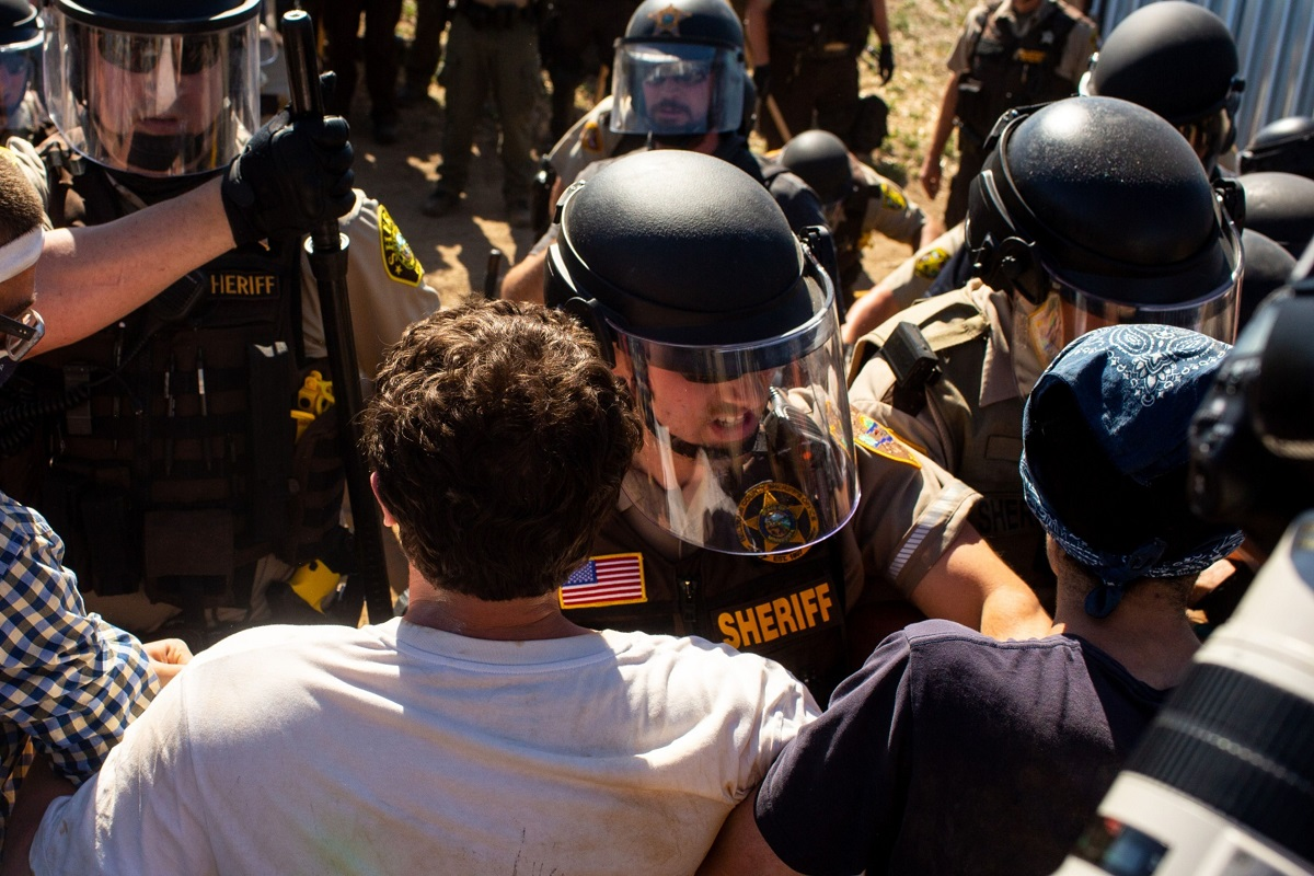Law enforcement officers clashing with demonstrators at an Enbridge Inc Line 3 pump station during a 'Treaty People Gathering' protest in Hubbard County, Minnesota, the US on June 7. (Photo by Bloomberg)