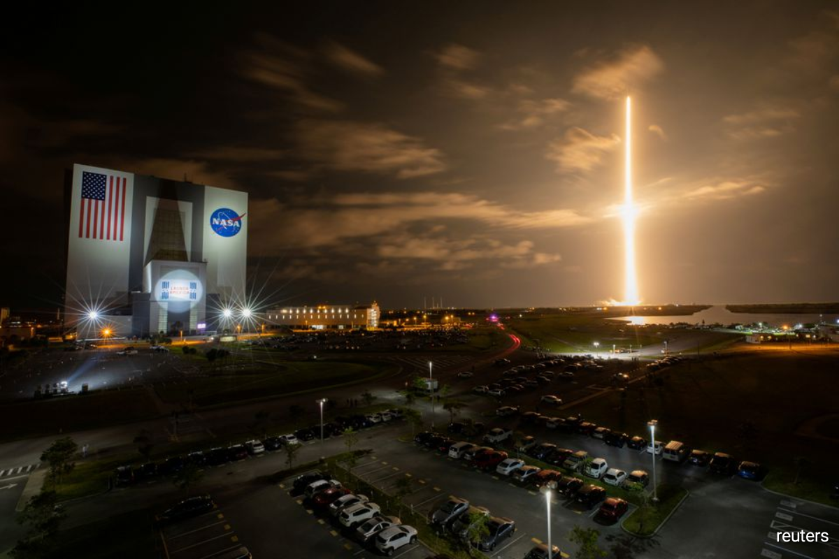 The crew vehicle, dubbed Resilience, was set for liftoff from NASA's Kennedy Space Center atop one of Musk's reusable Falcon 9 rockets, with a five-hour targeted launch window that opens at 8 p.m. EDT (0000 GMT) on Wednesday.