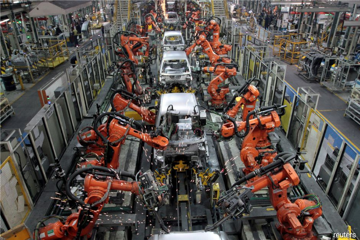 Ford cars are assembled at a plant of Ford India in Chengalpattu, on the outskirts of Chennai, India, March 5, 2012.