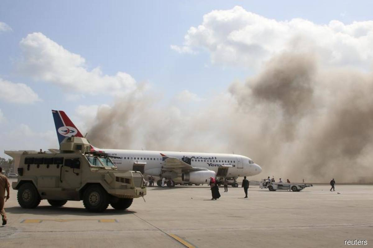 Twenty killed in attack on Aden airport moments after new Yemen cabinet lands