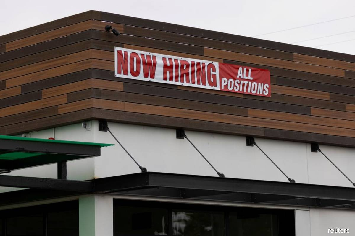 A restaurant advertising jobs looks to attract workers in Oceanside, California, US on May 10, 2021. (Photo by Mike Blake/Reuters filepix)