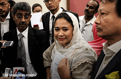 Sacked from Umno, defiant Anina says struggle not over