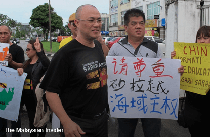 Activists protest against China's intrusion into Sarawak waters