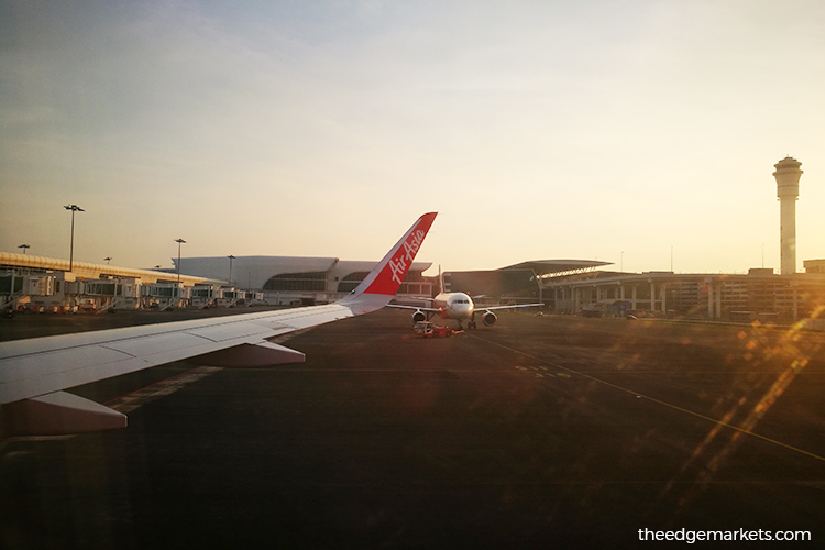 402 AirAsia passengers urged to go for tests after detection of COVID-19 cases