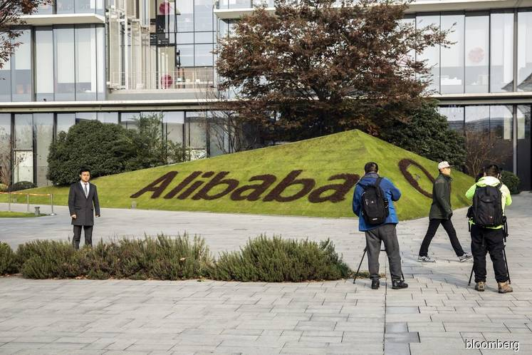 Alibaba profit up but revenue growth eases