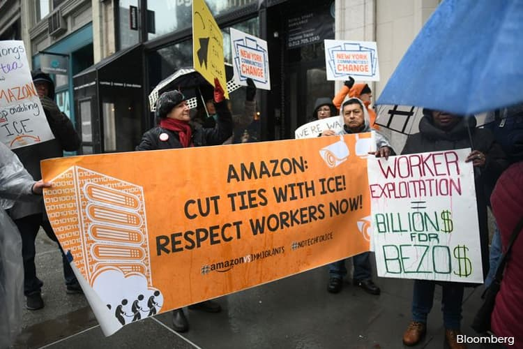 Amazon Critics Rally at Bezos NYC Penthouse for Cyber Monday