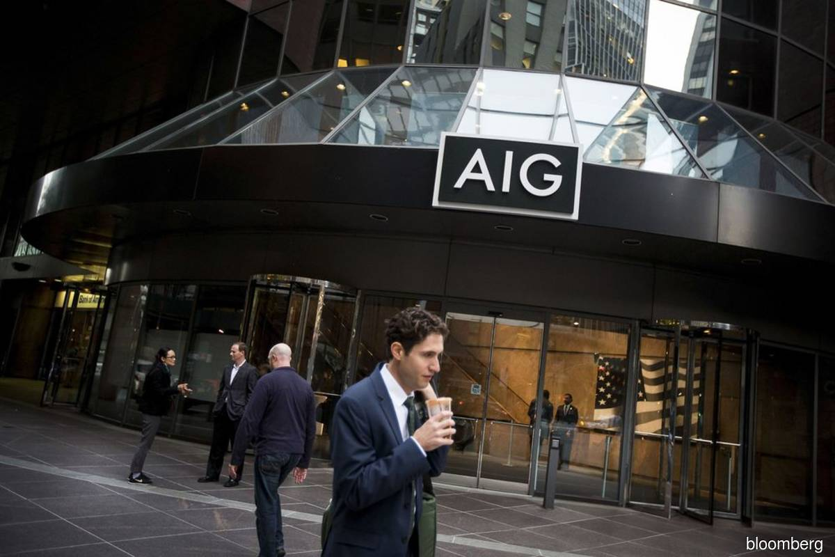 AIG posts US$7.9 billion loss driven by deal to unload risks