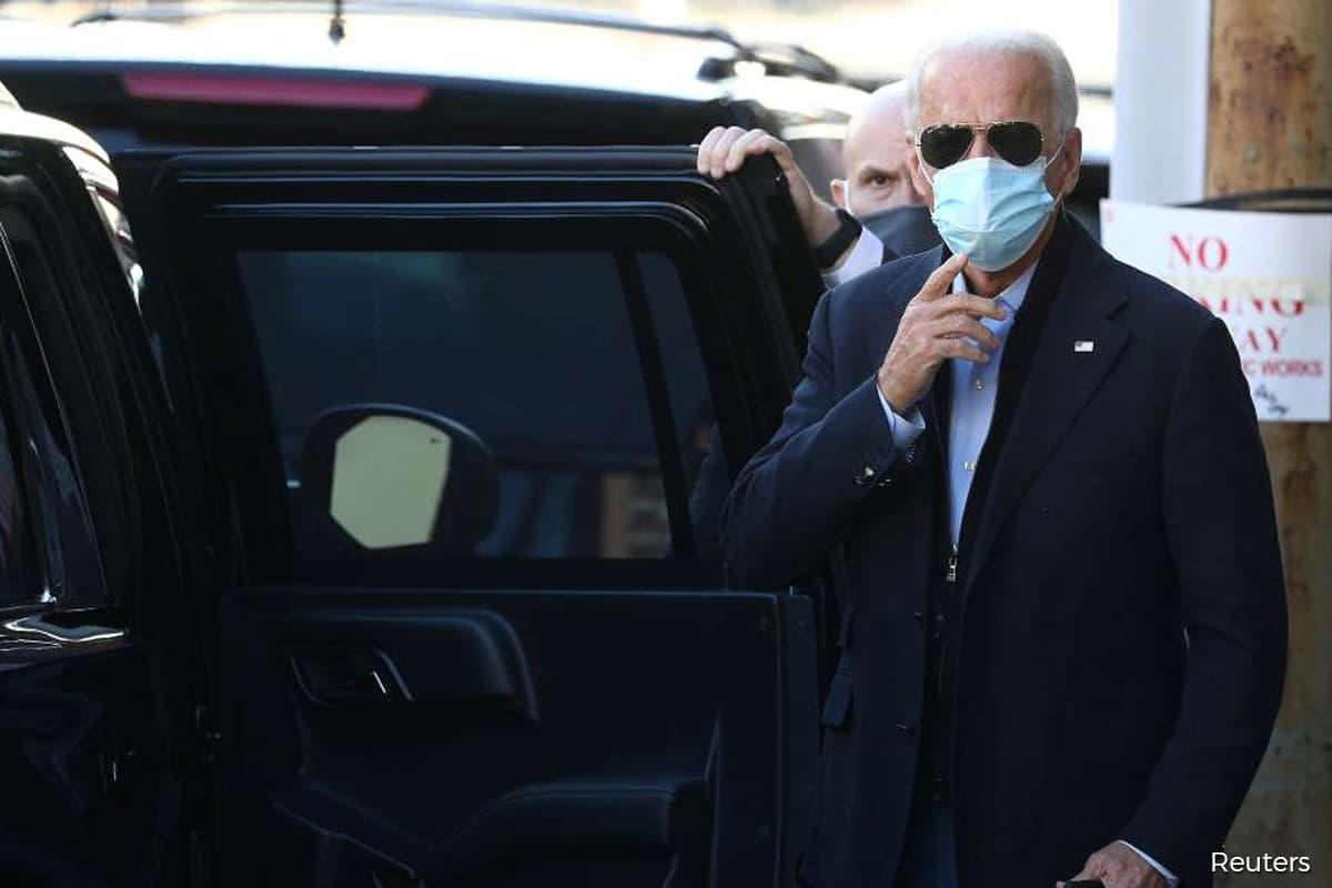 Amid coronavirus spike, pressure grows on U.S. agency to approve Trump-to-Biden transition