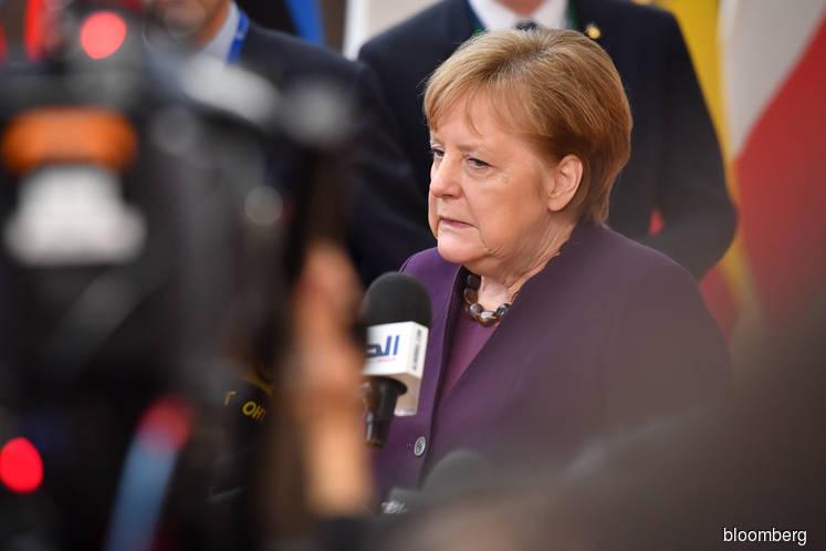 Merkel offers breakthrough deal to shield EU from virus fallout