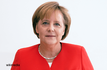Merkel says to do all she can to secure Opel jobs in Germany