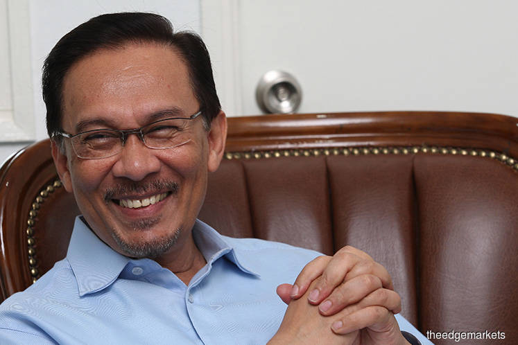 Anwar Ibrahim: Staying out for now to give Mahathir 'free hand'