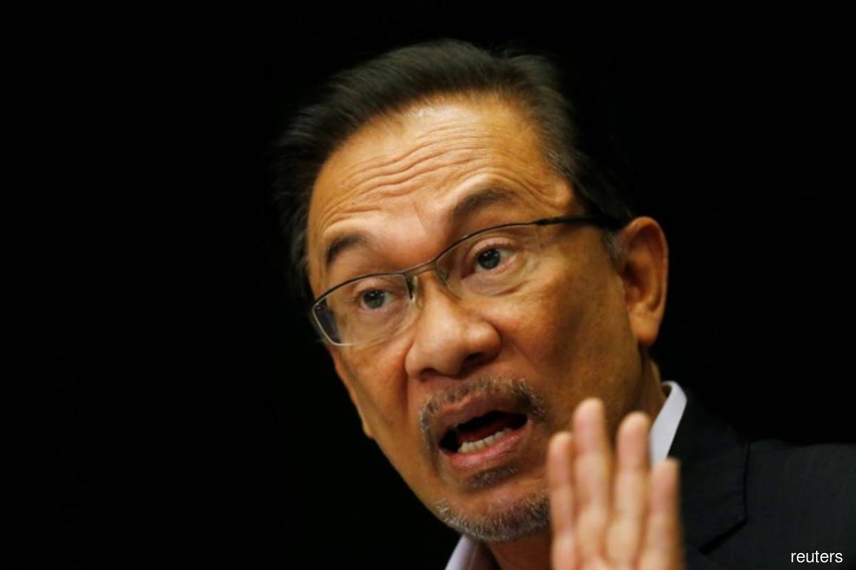 A week after Anwar (pic) laid claim to the premiership, citing enough parliamentary support to form a new government, the political situation is fluid and the power to decide what happens next rests with the King who is currently hospitalised. (Photo by Reuters)