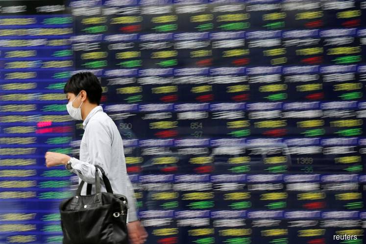 Asia shares touch 3-month top, cautious on Fed