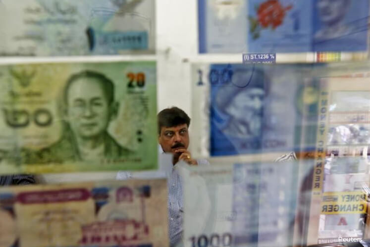 Most Asian currencies firm as Fed's easing signals hobble dollar