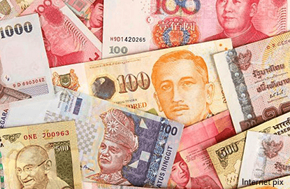 Several Asian currencies set to post best weekly gains in months