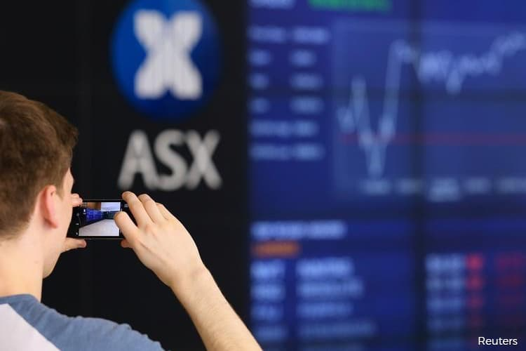 Australian shares rise for third day as rate cut spurs banks