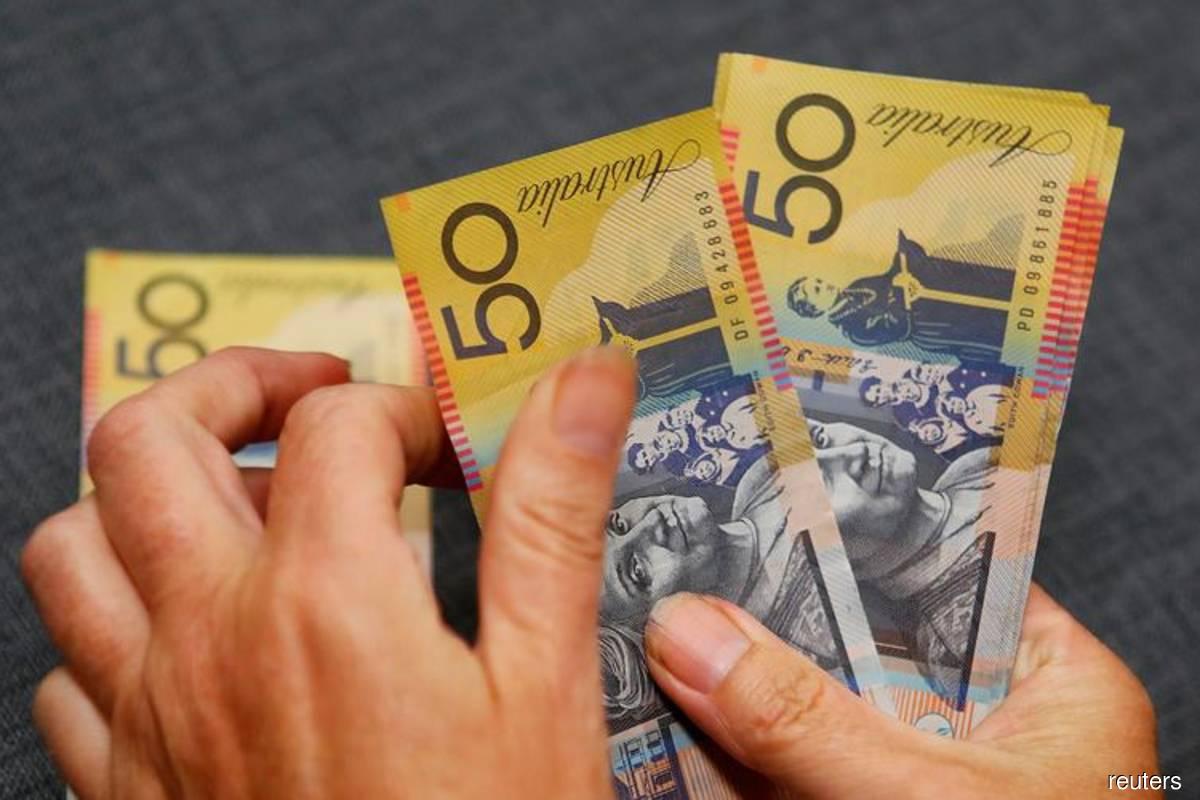 Australian dollar falls as RBA delivers tapering with dovish twist