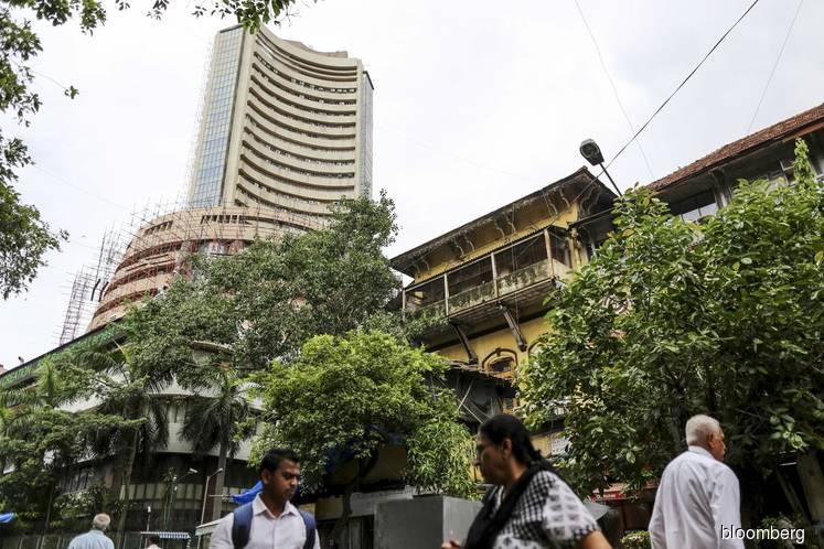 Sensex completes third week of gains as investors weigh outlook