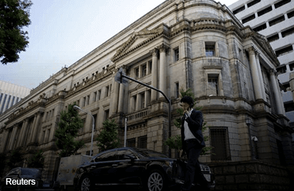 Abenomics to intensify, but economists split on further monetary easing