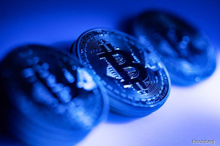 Bitcoin Climbs Above $7,000 as Cryptocurrency Rally Extends