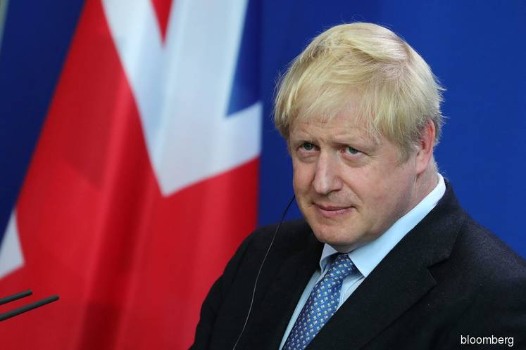 U.K.'s Johnson plays down hopes of quick Brexit deal with EU