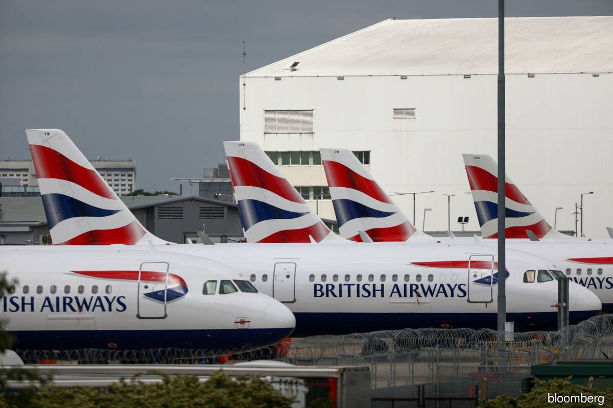 British Airways owner IAG posts €1.3b loss, cuts schedule