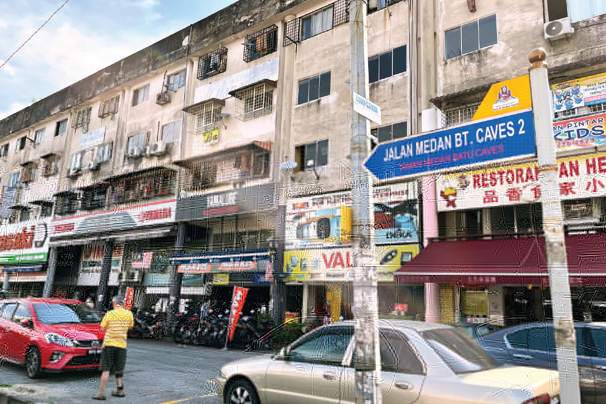 One of the main streets in Medan Batu Caves is Jalan Medan Batu Caves 2, which is lined with mainly 4½-storey shop apartments (Photo by Sam Fong and Suhaimi Yusuf/The Edge)