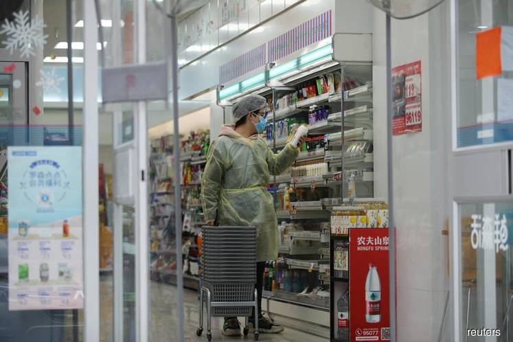 A worker is seen inside a convenience store on Feb 11, 2020, following the outbreak of the 2019 novel coronavirus (COVID-19) in Wuhan, Hubei province, China. (Photo credit: Stringer/REUTERS)