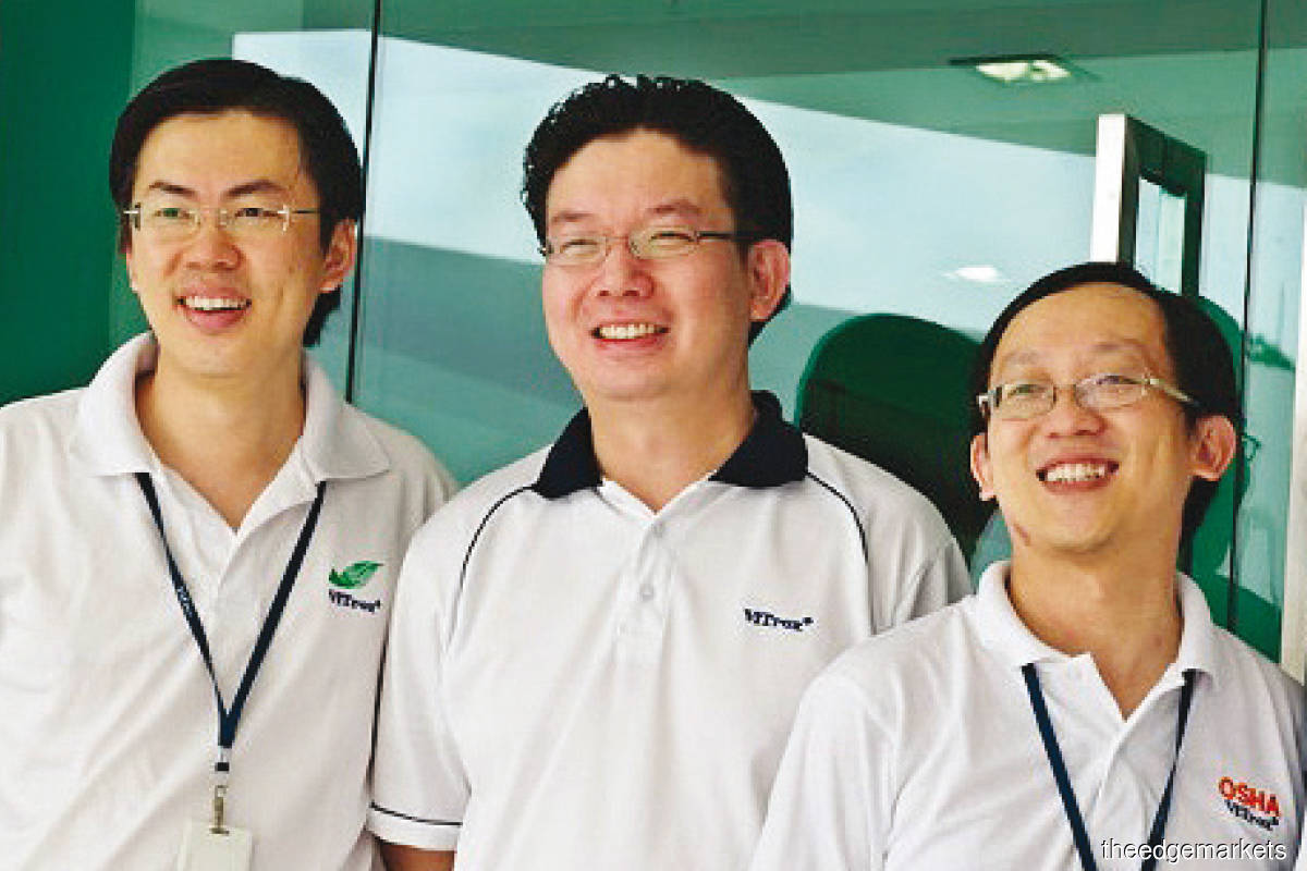 (From left) Chu, Siaw and Yeoh in October 2011, when ViTrox officially moved into its four-storey block at Campus 1.0