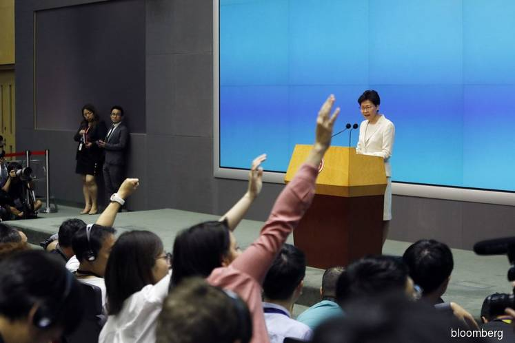 Hong Kong government refutes reports on chief Carrie Lam's resignation plans