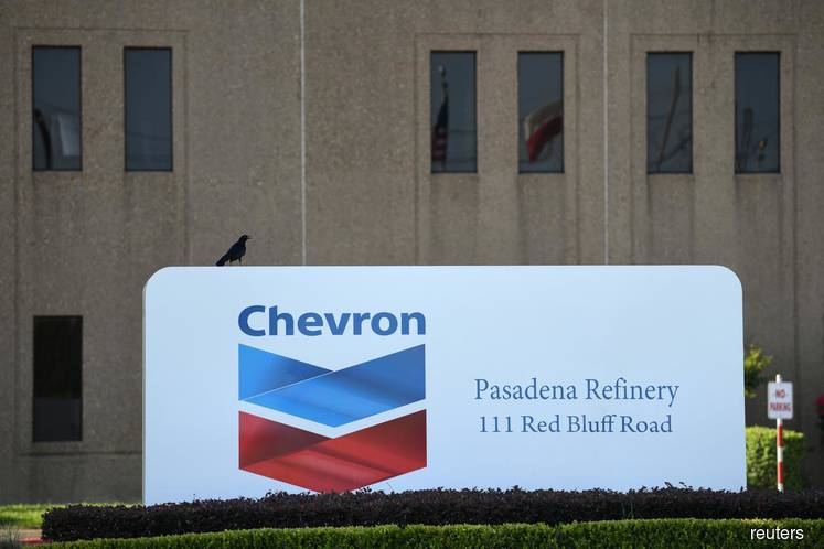 Chevron expects $10 bln-$11 bln charge in 4th qtr; plans asset sales