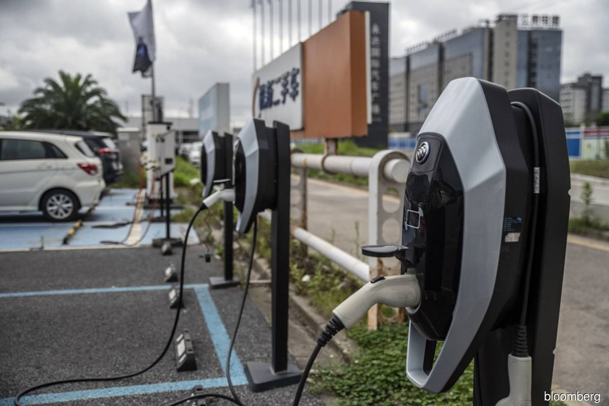 China vows to boost car sales, EV charging facilities