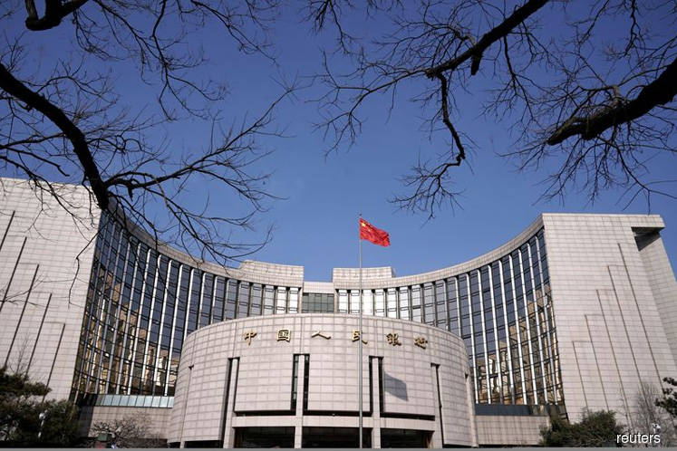 China cuts benchmark lending rate to prop up economy