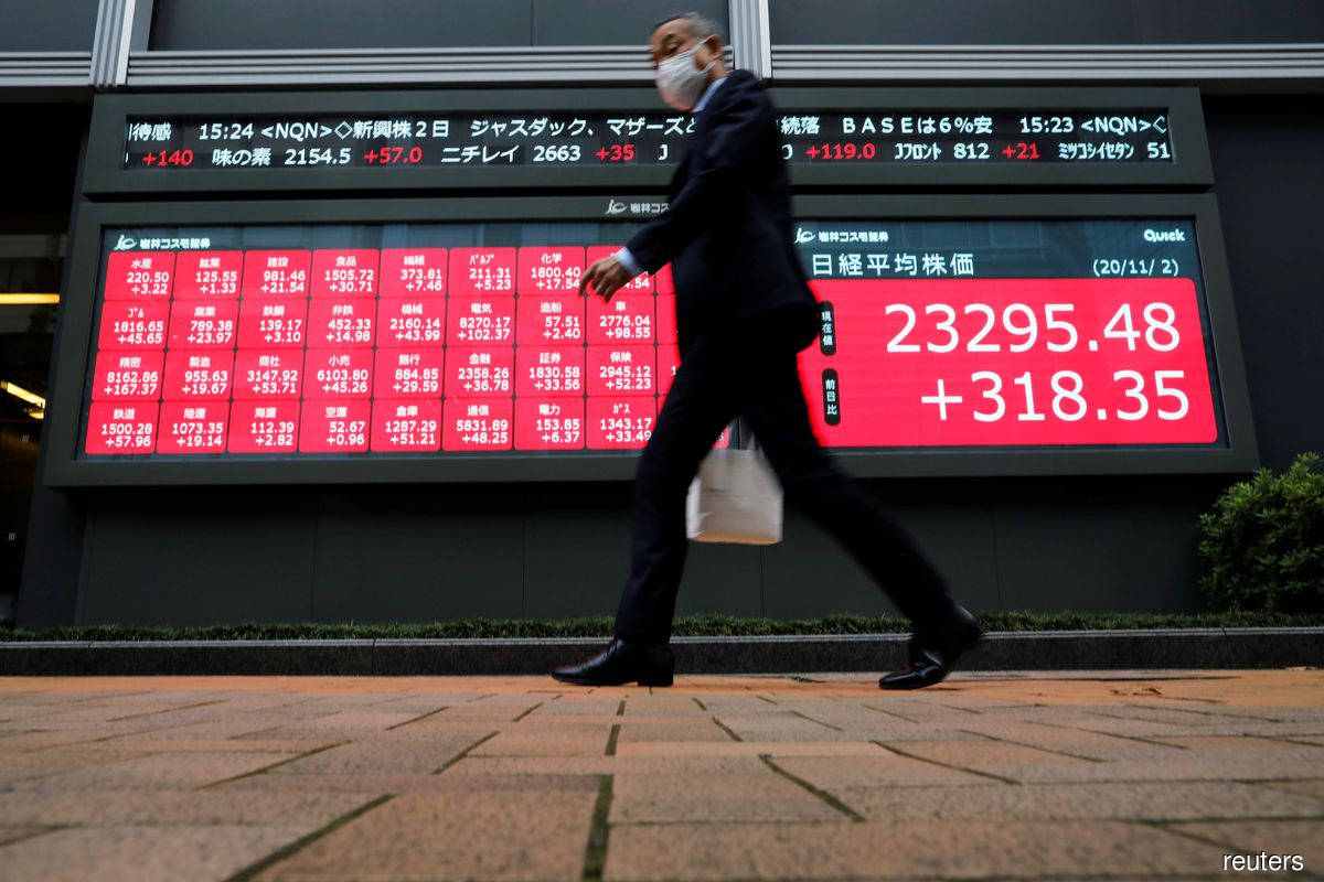 World shares jolted by Evergrande crisis as debt payment test looms