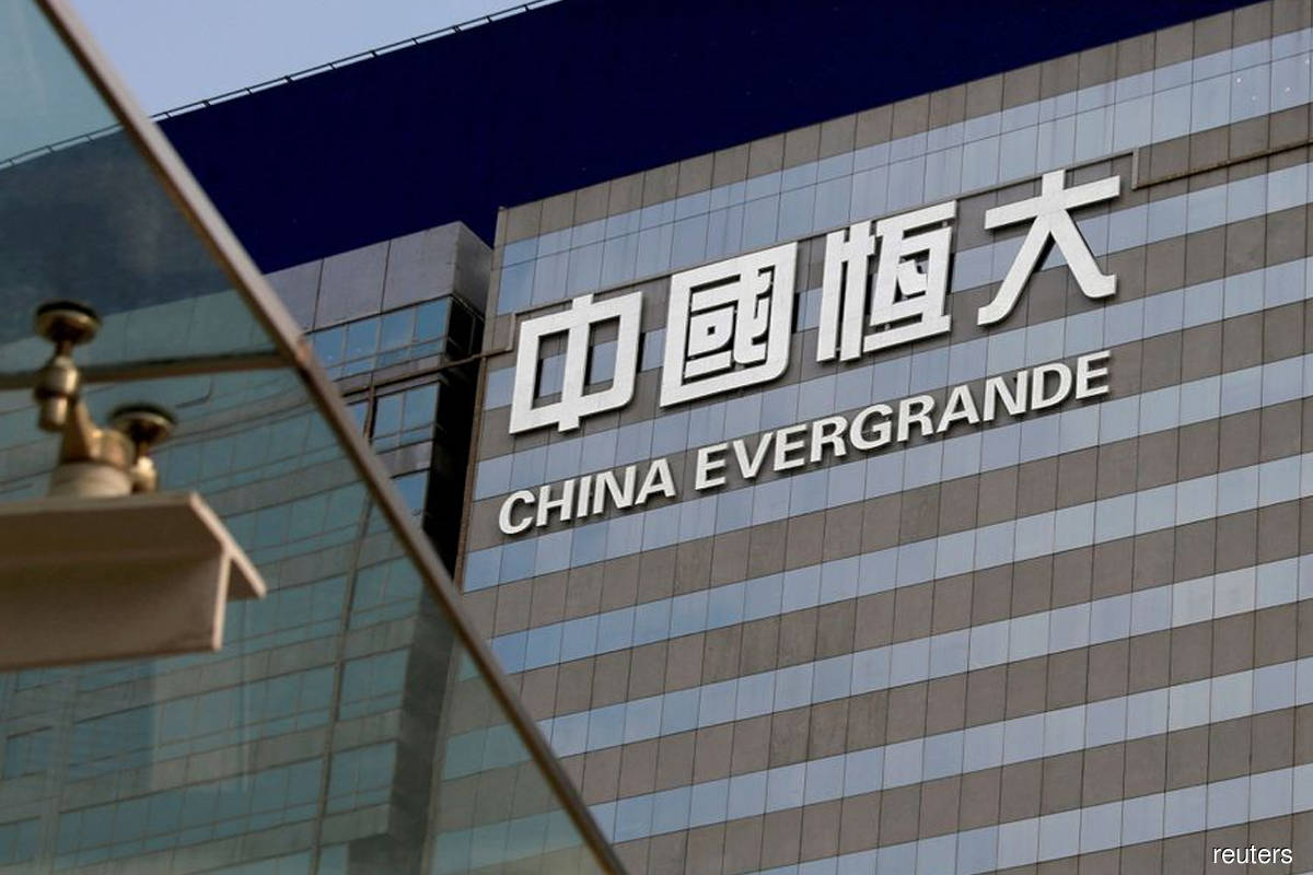 Evergrande's wild swings show risks in China's local bond market