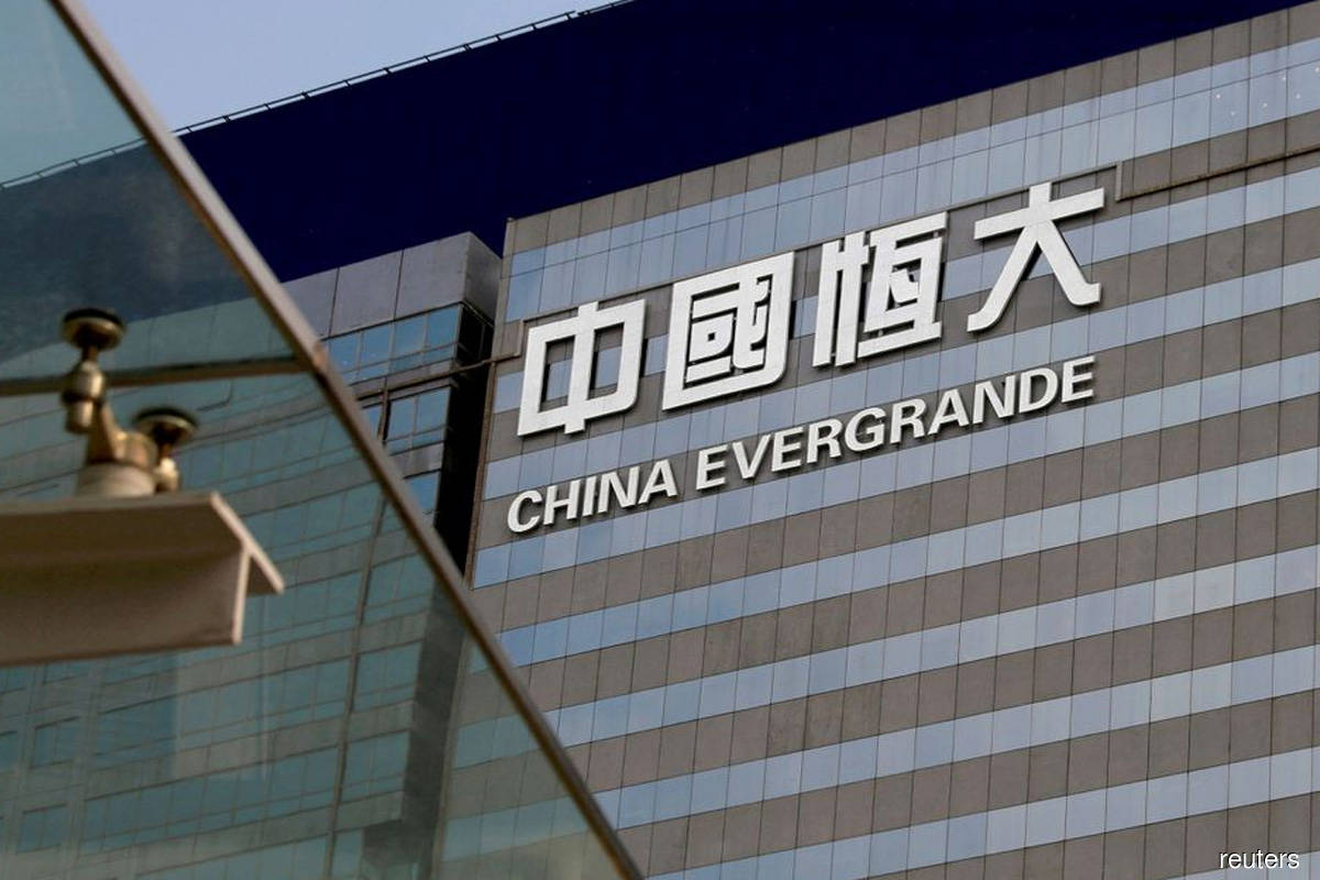 Investors grappling with Evergrande fallout weigh risk of wider pain