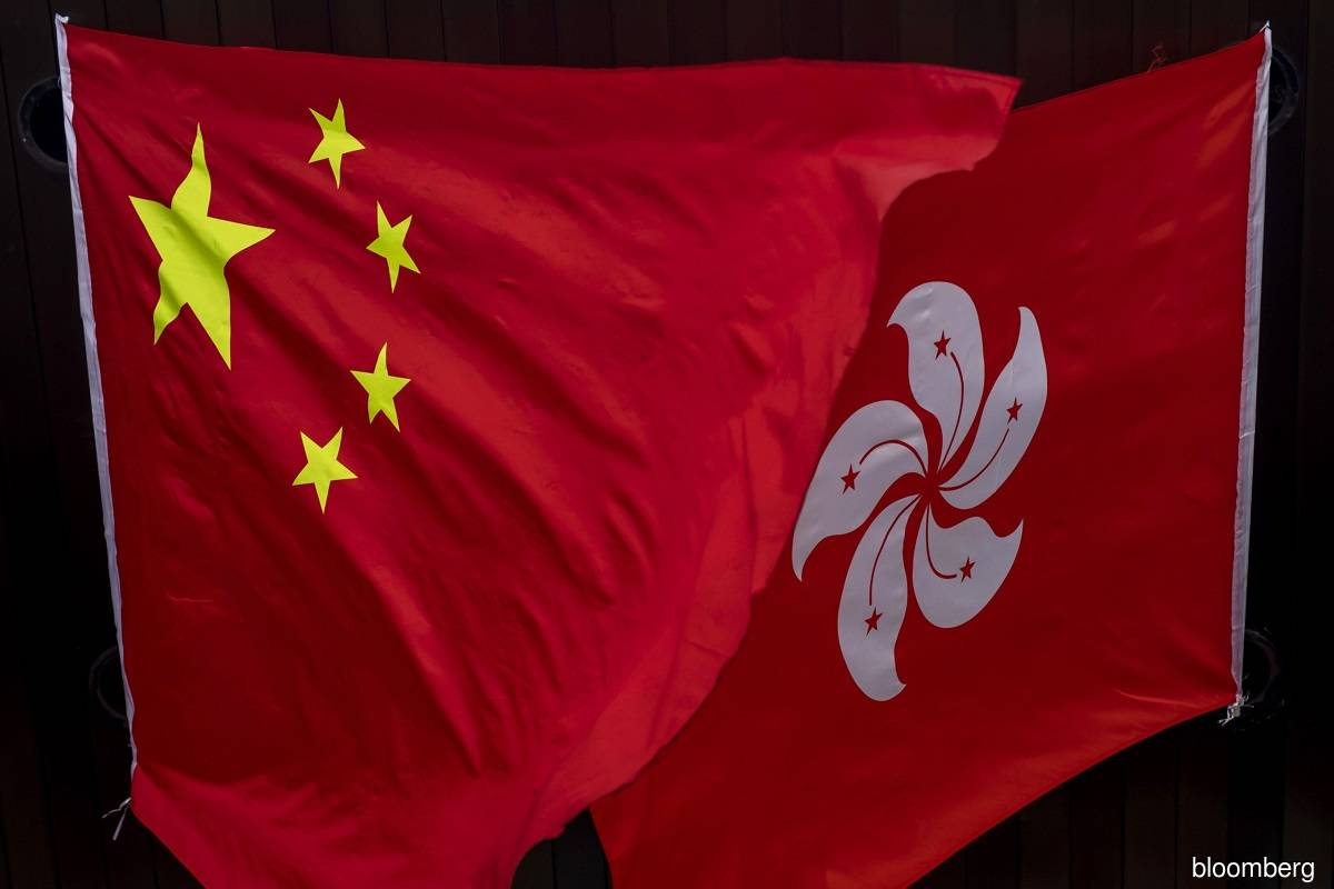 Hong Kong minister seeks to ease firms' worries on sanctions law