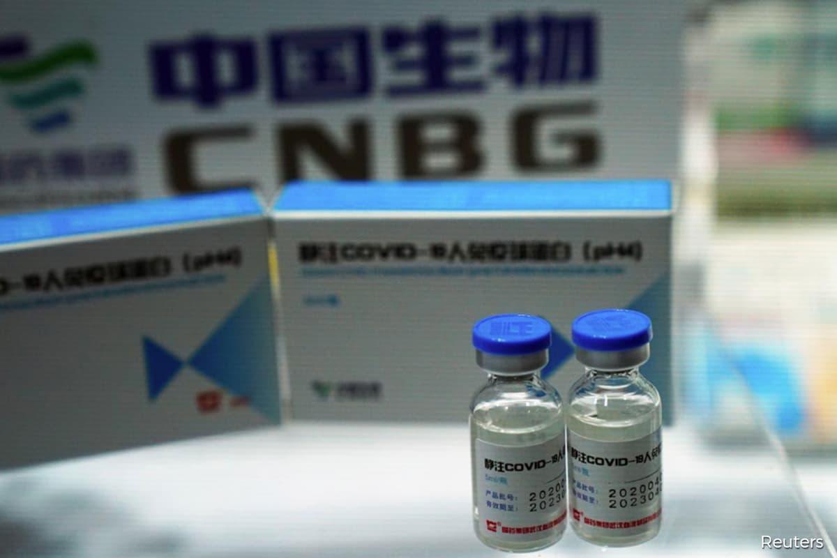 China vaccine front runner says shots safe amid AstraZeneca setback