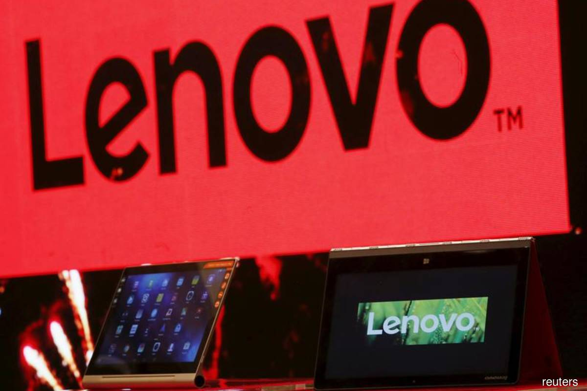 A Lenovo ultrabook and a tablet are displayed during a news conference in Hong Kong, China on May 21, 2015. (Photo by Bobby Yip/Reuters filepix)